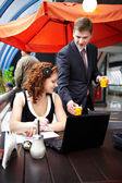 Young business woman and her partner on lunch — Stock Photo