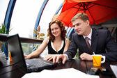 Joyful man and woman on business lunch — Stockfoto