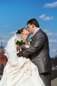 Romantic kiss bride and groom — Stock Photo