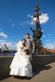 Bride and groom about monument to Peter the Great — Stock Photo