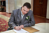 Elegant groom on solemn registration of marriage — Stock Photo