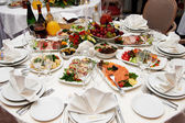 Festive table setting for banquet — Stock Photo