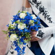 Beautiful bouquet in her hand the bride — Stock Photo