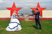 Newlyweds on a background of red stars — Stock Photo