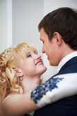 Happy embrace bride and groom — Stock Photo