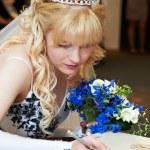 Bride puts signature on solemn registration of marriage — Stock Photo #42040641