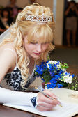 Bride puts signature on solemn registration of marriage — Stock Photo