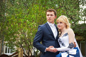 Bride and groom on floral background — Stock Photo