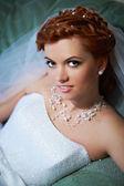 Portrait beautiful bride lying on bed — Stock Photo