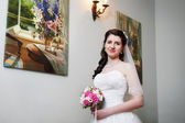 Happy bride about paintings — Stock Photo