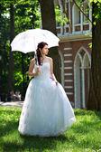 Happy bride on walk — Stock Photo