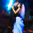 Kiss and dance young bride and groom — Stock Photo