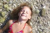 Little girls on beach of sea — Stock Photo