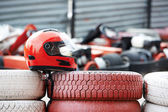 Red helmet with visor is on tires — Stock Photo