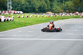 Little karting racer on the track — Stock Photo