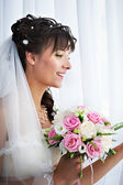 Happy bride with weding bouquet — Stock Photo