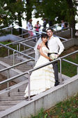 Bride and groom on stairs — Stock Photo