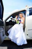 Happy bride in wedding limousine — Stock Photo