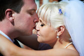 Gentle kiss the bride and groom — Stock Photo