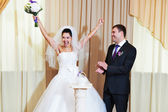 Funny bride and groom in delight — Stock Photo