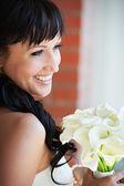 Happy bride with wedding bouquet — Stock Photo