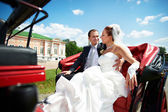 Bride and groom in beautiful carriage — Stock Photo