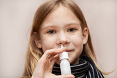 Little girl using nasal drops — Stock Photo