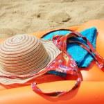 Beach items on orange inflatable mattress — Stock Photo #48226053