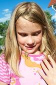 Grasshopper and happy girl — Stock Photo