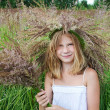 Girl in a wreath of grass with spikelets — Stock Photo #51519769