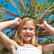 Girl in a wreath of grass with spikelets — Stock Photo #51520059