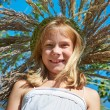Girl in a wreath of grass with spikelets — Stock Photo #51520127