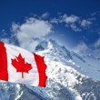 Stock Photo: Canada flag and mountains