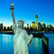 Liberty Statue with New York ar night — Stock Photo #32898625