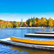 Pier with autumn lake — Stock Photo