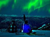 Northern lights over snow mountain peak — Stock Photo