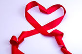 Red ribbon of love — Stock Photo