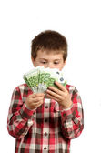 Child hidden behind money — Stock Photo