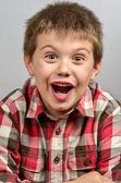 Criança fazendo feio enfrenta 5 — Fotografia Stock