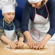 Royalty-Free Stock Photo: Mother and son making a pizza 9