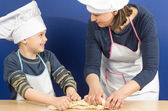 Mother and son making a pizza — Stock Photo
