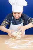 Kneading dough boy — Stock Photo