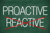Proactive and Reactive handwritten — Stock Photo