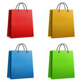 Shopping bags red orange blue and green isolated — Stock Photo