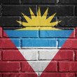 Antigua and Barbuda flag on a textured brick wall — Foto Stock