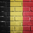 Belgium flag on a textured brick wall — Stock Photo
