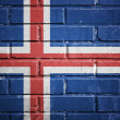 Iceland flag on a textured brick wall — Foto de Stock
