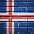 Iceland flag on a textured brick wall — Zdjęcie stockowe