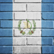 Guatemala flag on brick wall — Stock Photo