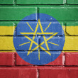 Ethiopia flag on brick wall — Stock Photo